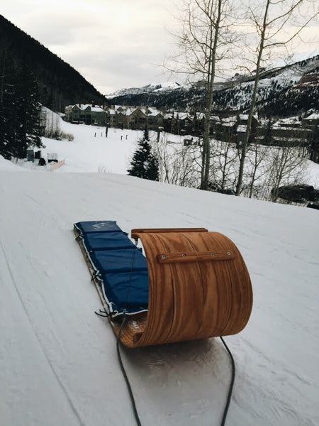Downhill 'boggin sled at the top of a hill overlooking snowy hills
