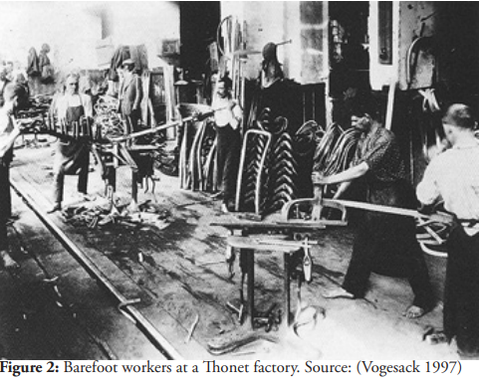Employees in a steam bending factory