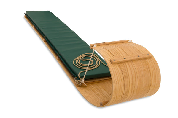 wooden toboggan with pad