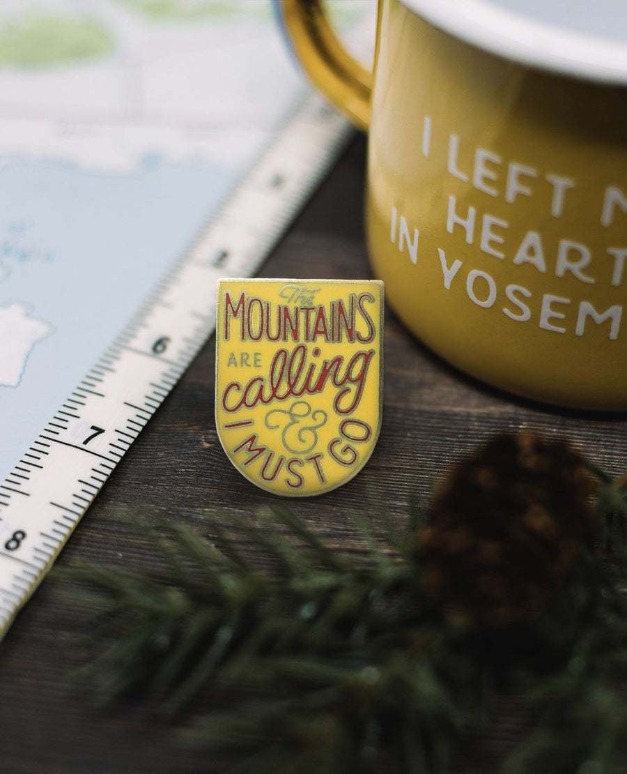The Mountains Are Calling & I Must Go Pin - Wondery, A Parks Apparel Brand