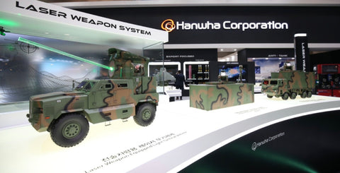 Hanwha Defence displays models of laser-based weapon systems.