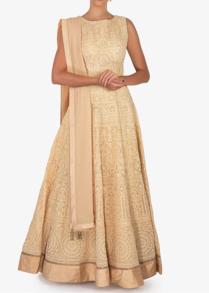 Cream anarkali suit featuring the heavy lucknowi thread work