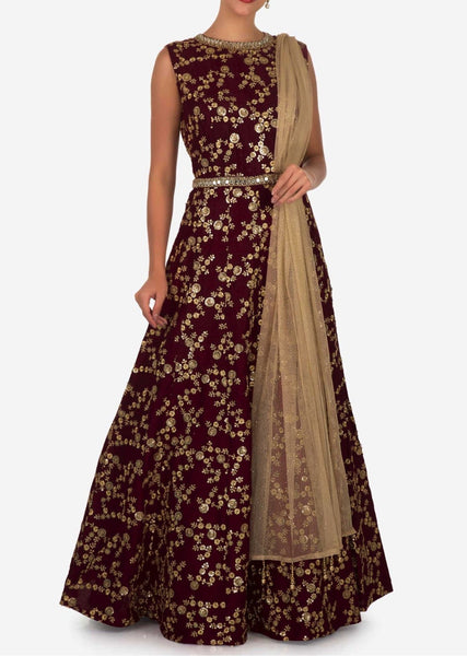Deep maroon suit in raw silk embellished with zari and mirror embroidery work