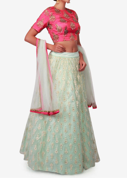 Mint blue lehenga in net with coral pink crop top embellished in thread and brocade butti work