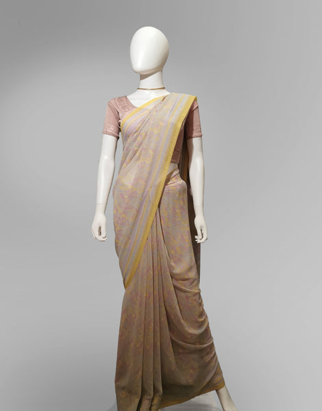 Saree in Light Peach Pink and Yellow with Traditional Print