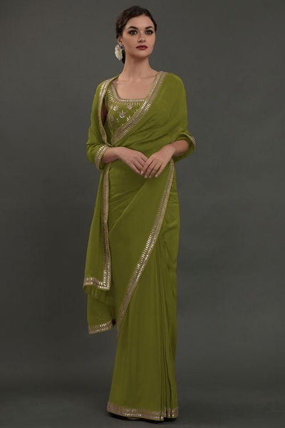 Saree in Avocado Green in Silver Embroidery - IFX