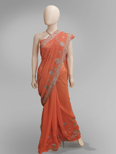 Saree in Vibrant Salmon Pink Pure Georgette - IFX