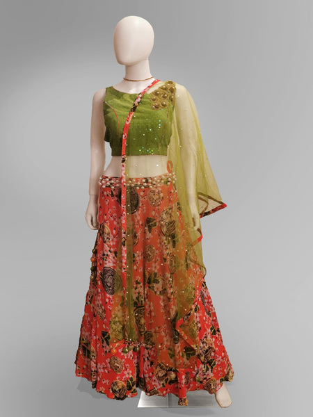 Lehenga in Coral Pink in Floral Motif and Green Strap Blouse