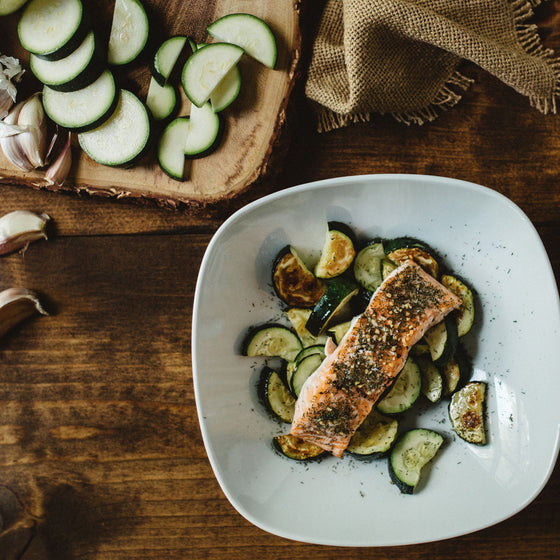 Baked salmon over roasted zucchini