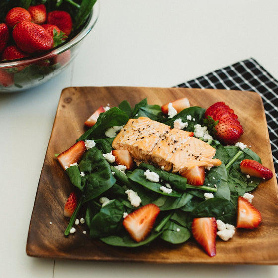 Salmon, spinach, berry & goat cheese salad