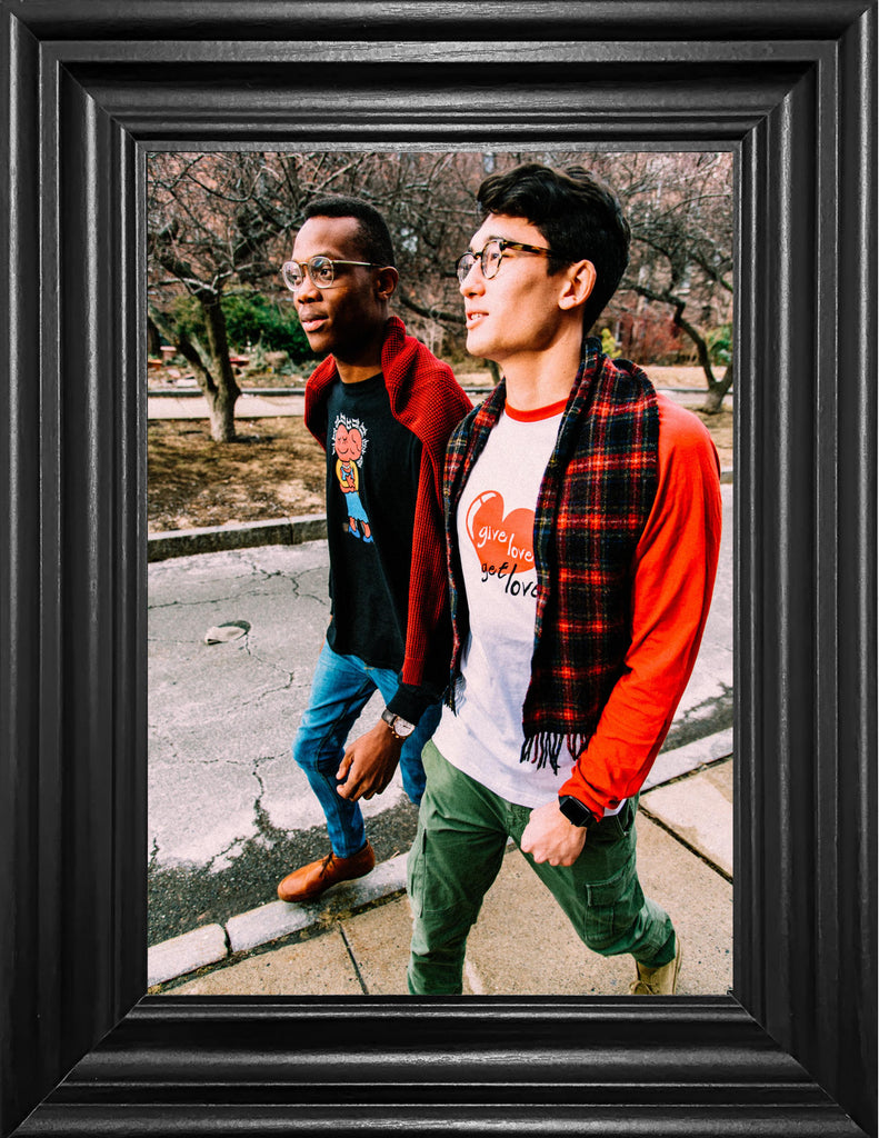An image of two guys wearing Buch America longsleeve shirts