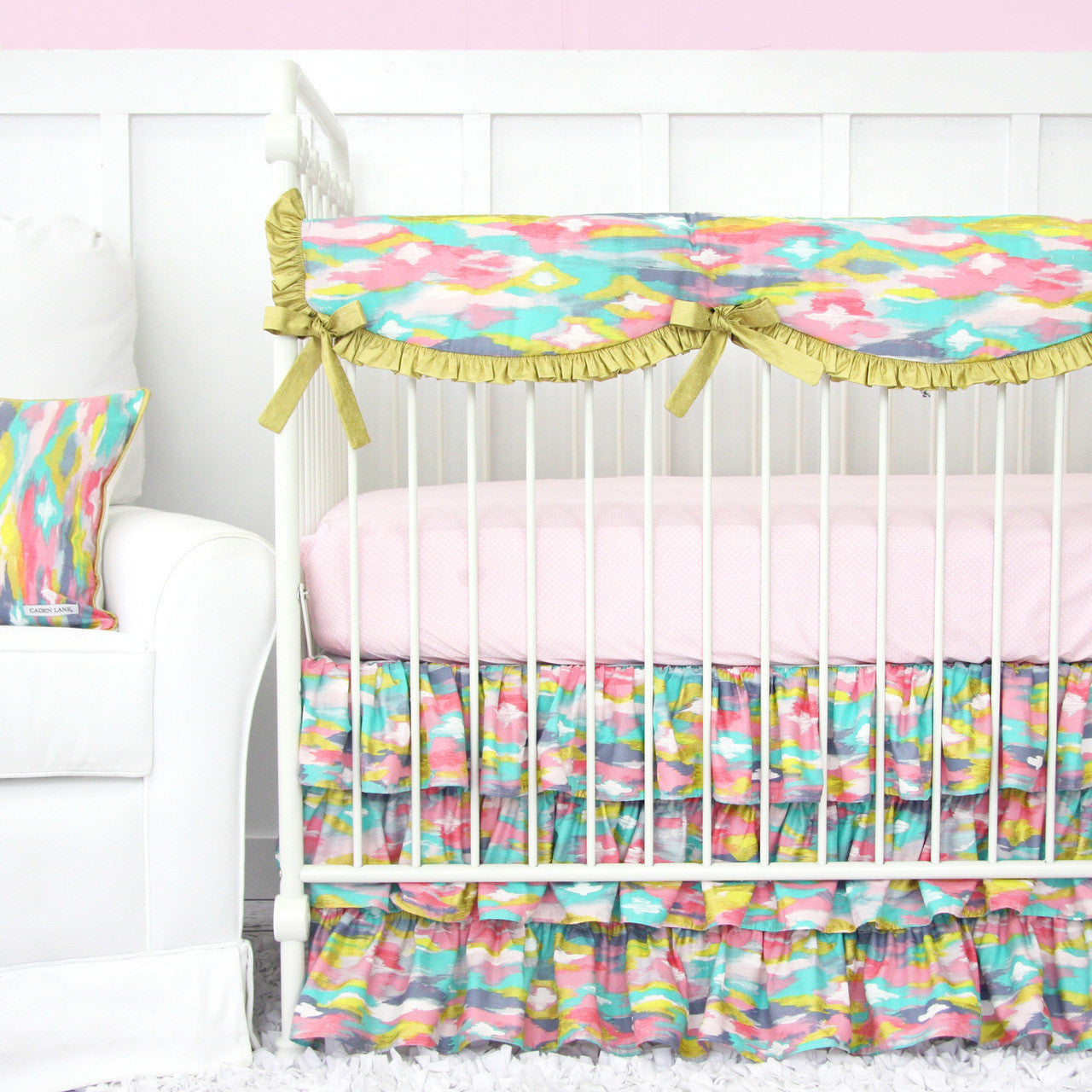 Pastel Nursery Design With Bright Pastel Baby Bedding