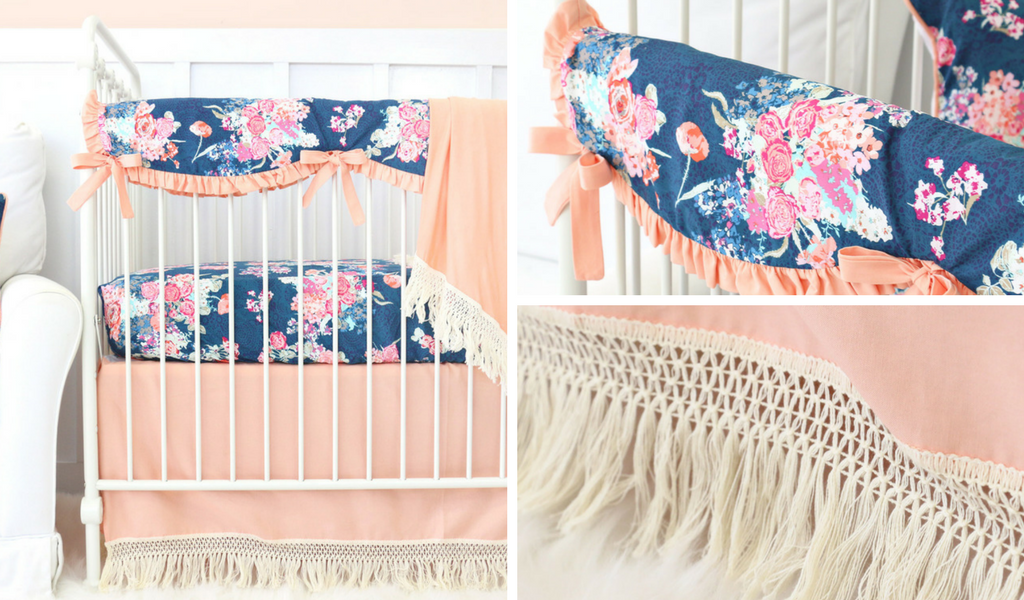 coral and navy bumperless bedding for a dark floral stylish nursery design