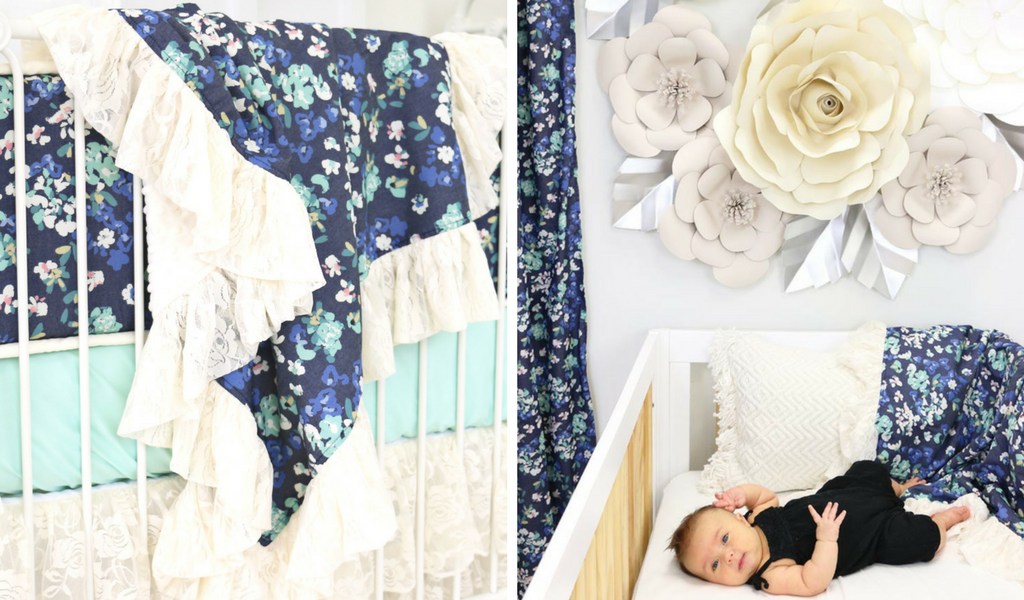 dark floral design with paper wall flowers and baby in crib