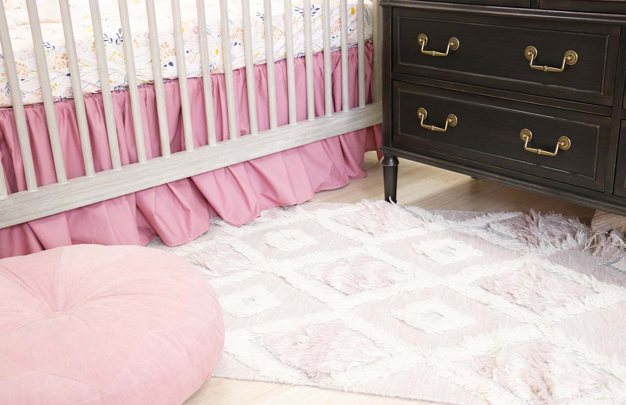 dusty rose accents for a boho girl nursery