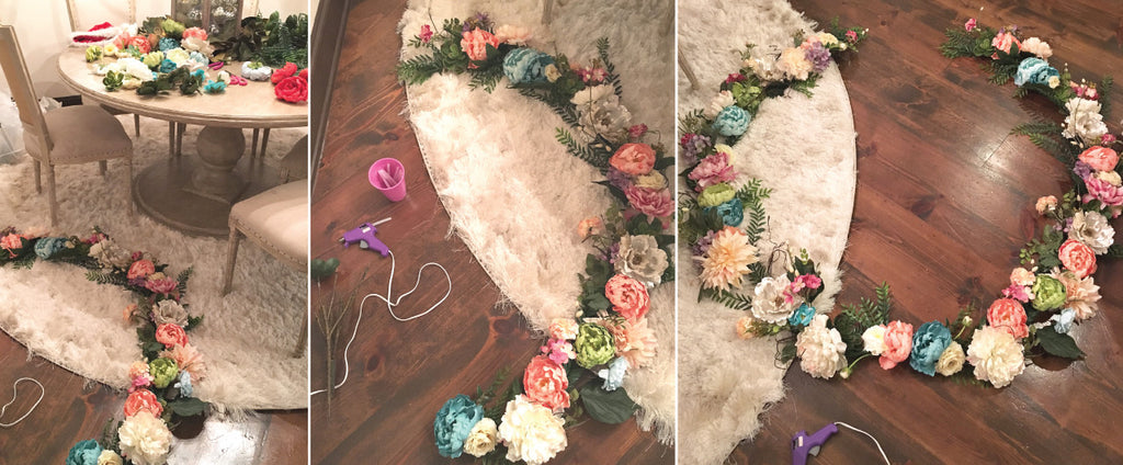 Hot Gluing Fake Flowers to a Garland to Make a Gorgeous Floral Wreath for Your Walls