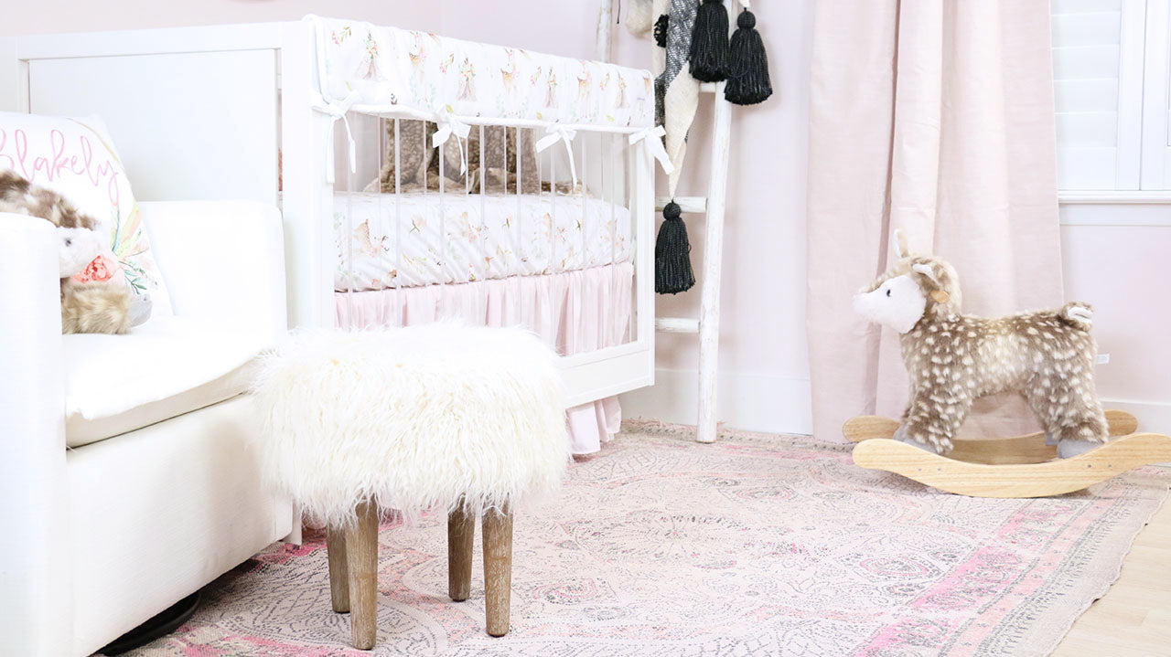 The sweetest modern girl woodland nursery with hints of pink
