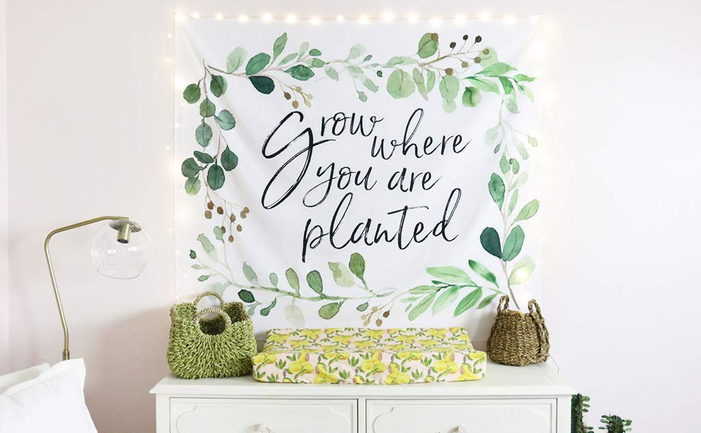 """Grow Where You Are Planted"" Greenery Tapestry above the Changing Table"