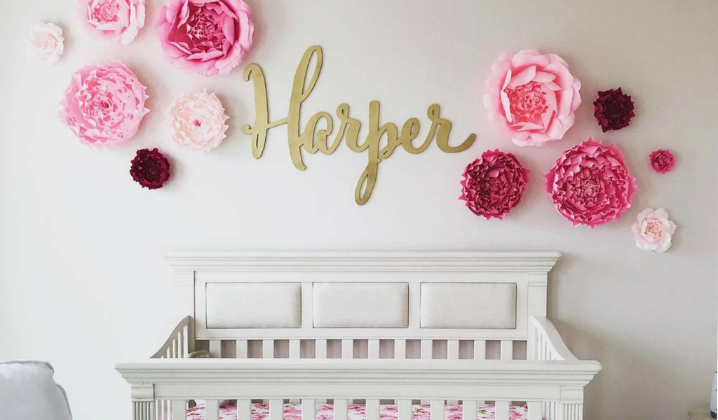 Giant Paper Flowers Wall Collage pink paper wall flowers with gold custom wood name sign