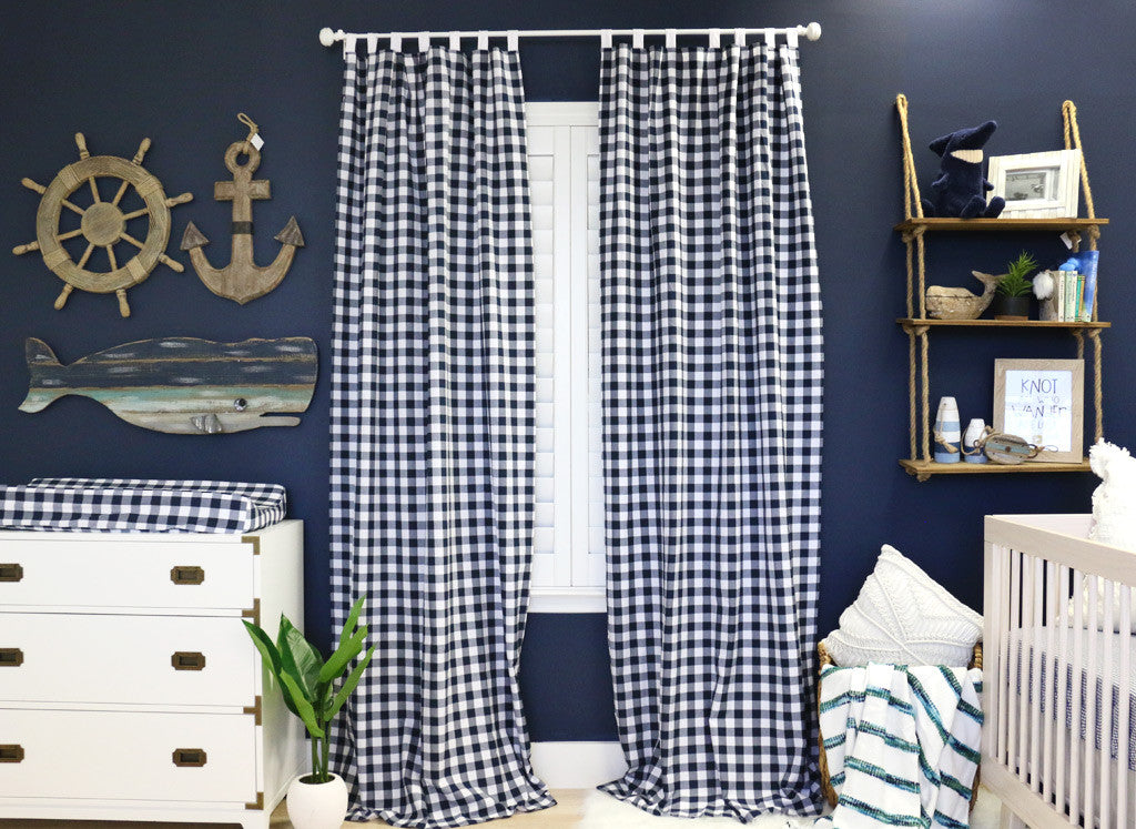 Gingham curtains for a nautical look in a navy baby boy's nursery