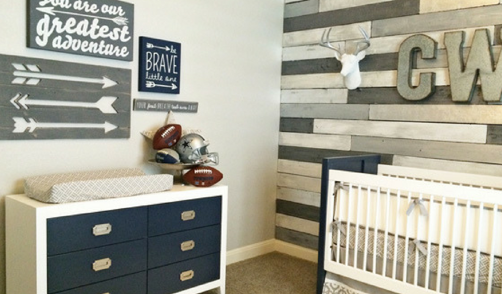 Navy and White Dresser with Football Accents and Rustic Wood Wall Art for a Modern Rustic Baby Boy Nursery
