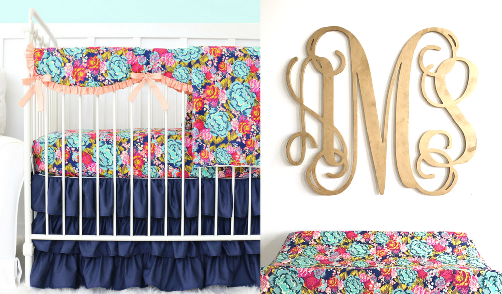 Navy boho inspired crib bedding with ruffle skirt and floral sheet floral changing pad cover and wood inital monogram wall hanging