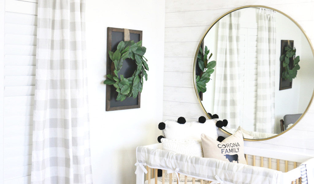 Modern Neutral Nursery with Oversized Brass Mirror above Crib