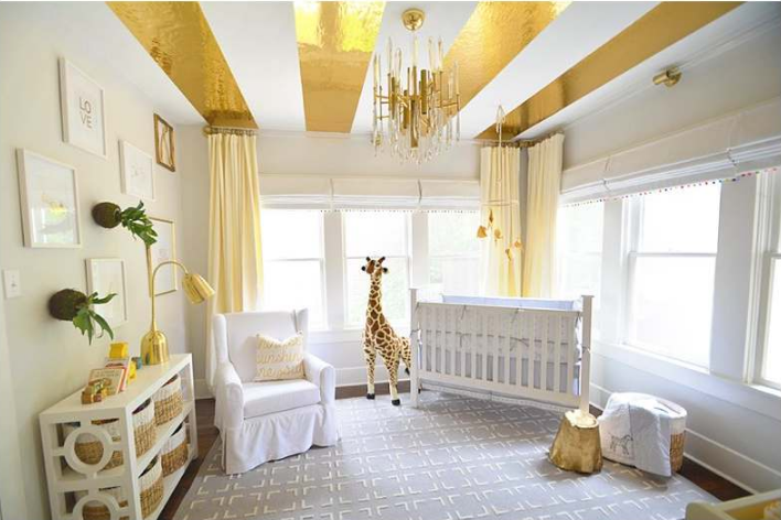 Stunning gold striped ceiling in the nursery