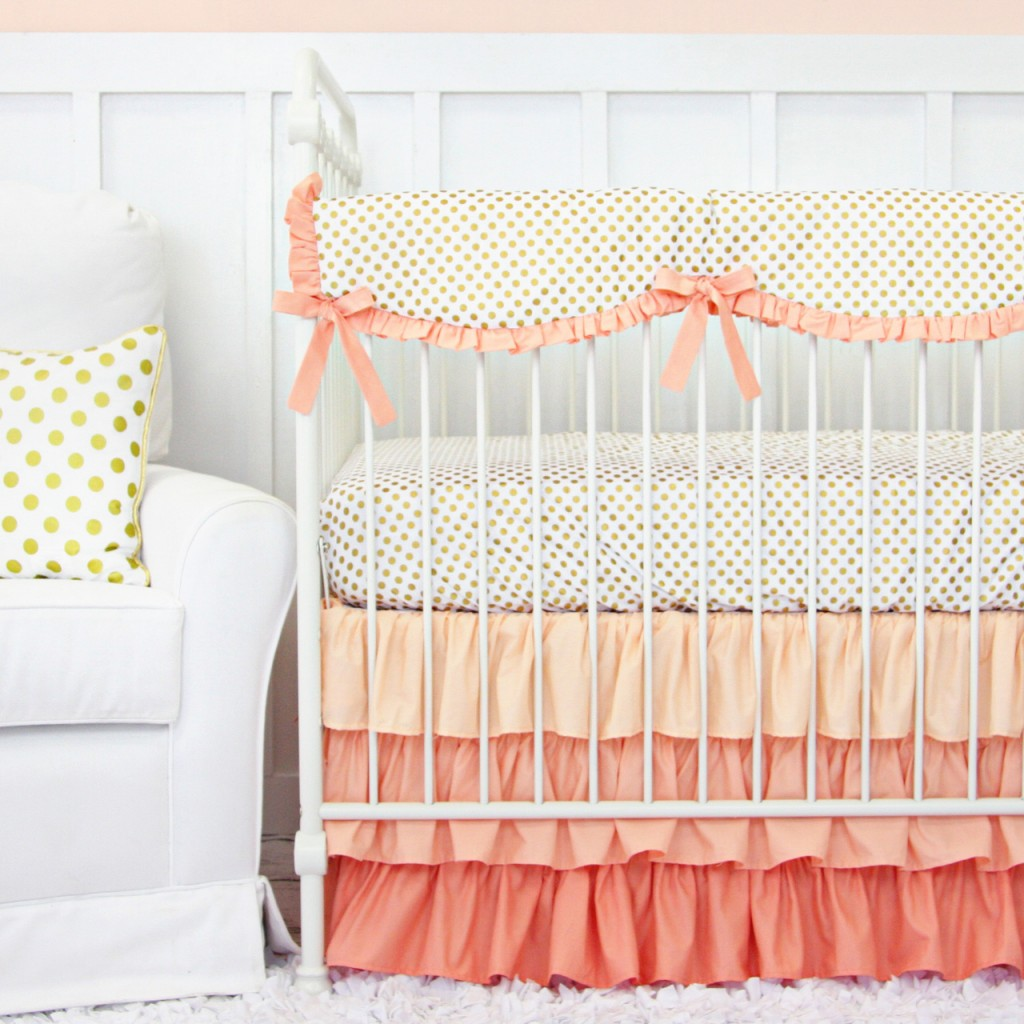 coral and gold dot crib bedding for a gold dot nursery