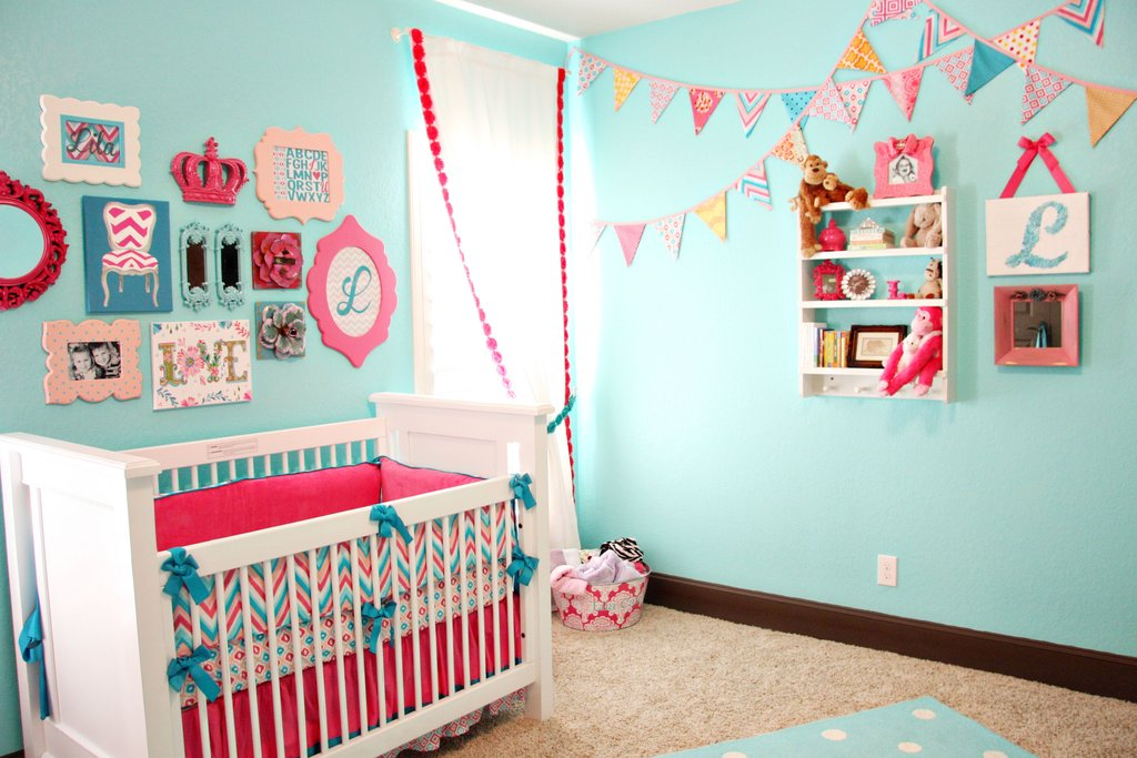 caden lane bunting wall in a pink and aqua nursery