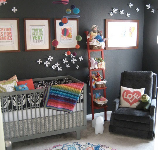 colorful gender neutral nursery with black walls