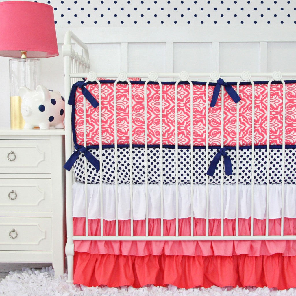 coral nursery ideas: coral and navy crib bedding