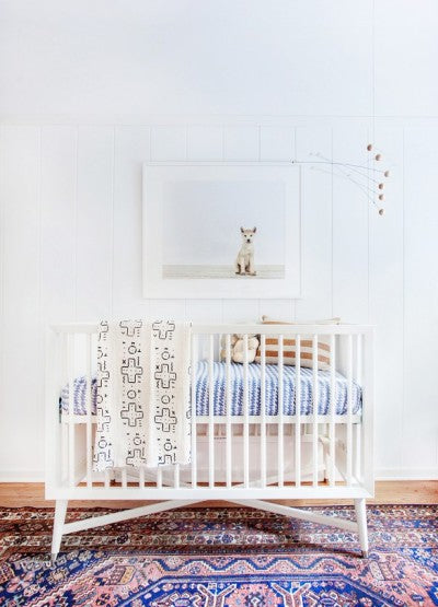 Mix and match textiles look stunning in this unique modern nursery