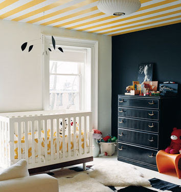 Bold yellow and white stripes on the ceiling