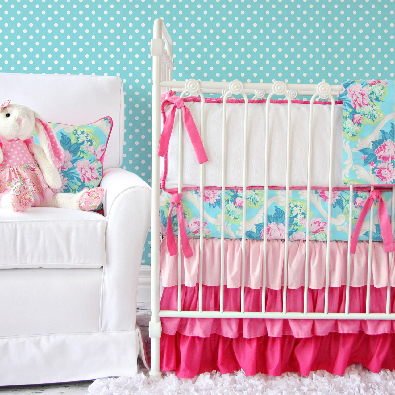 pink and aqua crib bedding for a baby girl