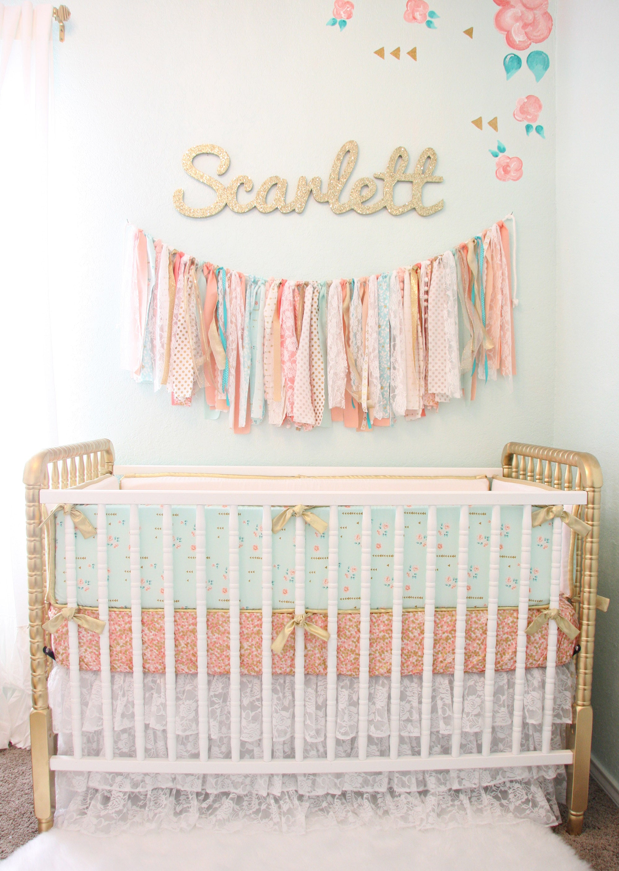 scarlett's vintage coral and gold crib with mixed and matched crib bedding