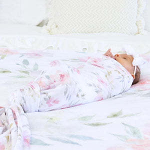 delaney pink floral newborn swaddle