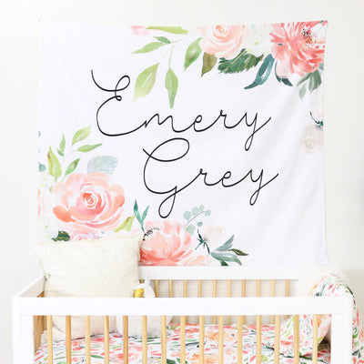 peach watercolor over the crib wall decor with baby girl's name