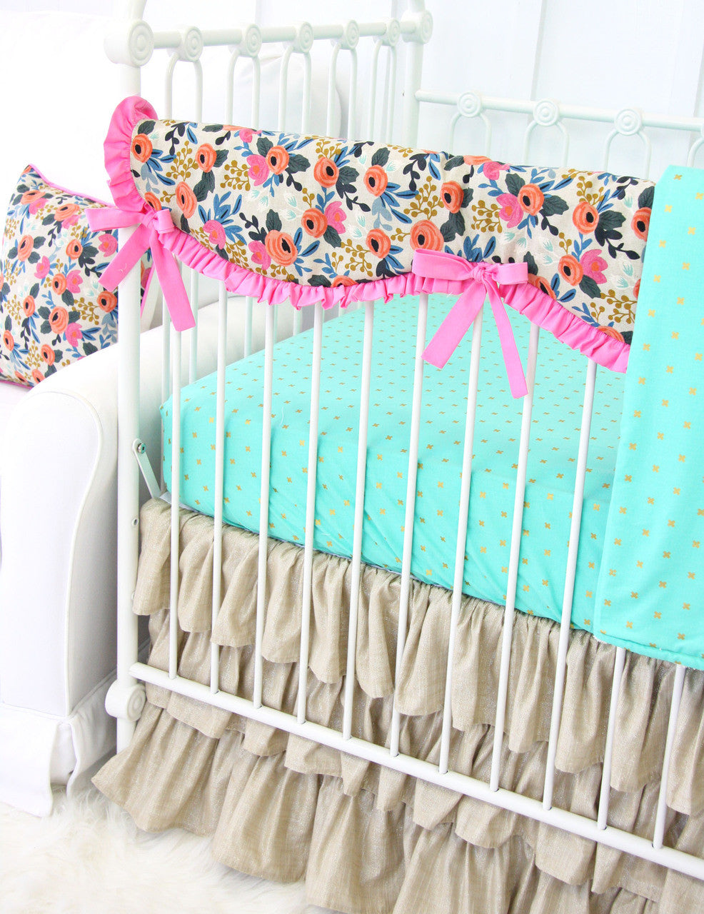 close up view of bumperless crib bedding collection with crib rail guard pink boho floral