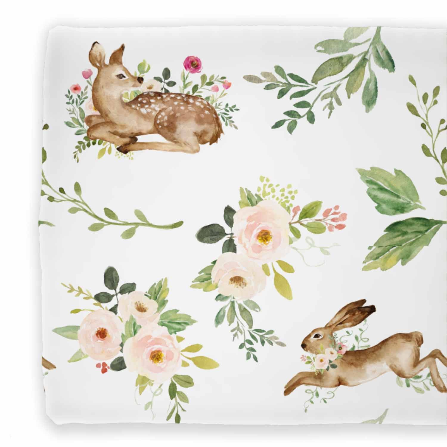 Changing pad cover with a pattern of flowers, deer, and bunny.