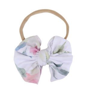 Delaney's Dusty Blush Floral Knit Bow Headband