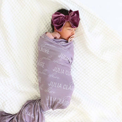 purple baby name swaddle