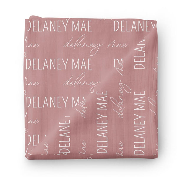 dusty rose block script swaddle baby name