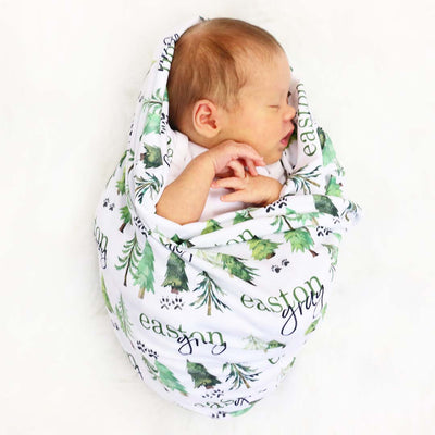 woodland tree personalized name swaddle blanket with cute baby