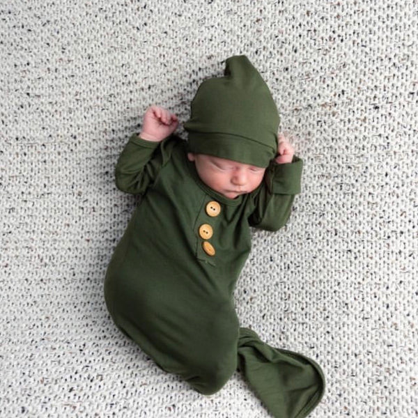 olive green knot gown with buttons and hat