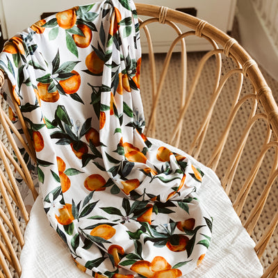 orange print swaddle blanket