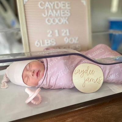 mauve personalized swaddle with babys name