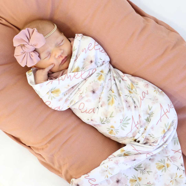 mauve and blush personalized floral swaddle