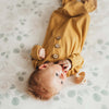 mustard knot gown on baby