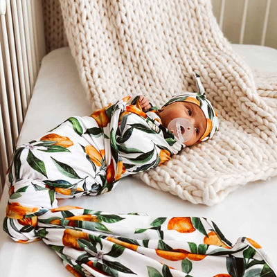 oranges neutral swaddle for boy or girl